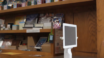 White iPad Mini App Demo Video in Landscape Position Inside a Library a15610