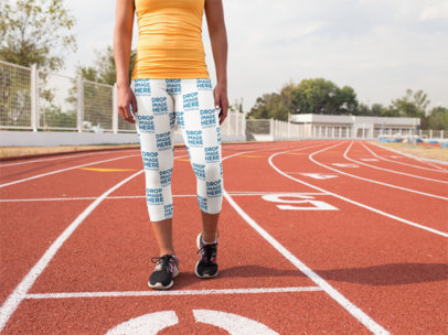 Mockup of a Girl Wearing Leggings While Walking at the Running Track a15325