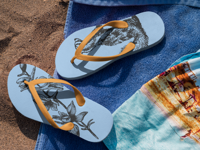 16c69e0bb Placeit - Two Flip Flops Mockup Lying Over a Towel at the Beach