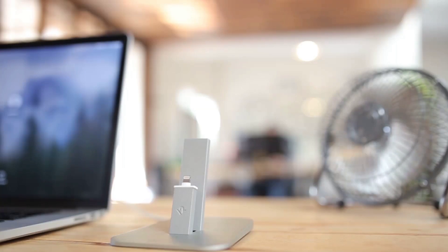 App Demo Video of a White iPhone Standing on a Wooden Desk Near a Fan and a Laptop a15779