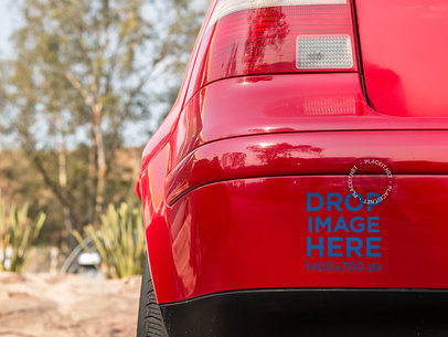 Square Sticker Mockup in the Back Bumper of a Red Car a15343