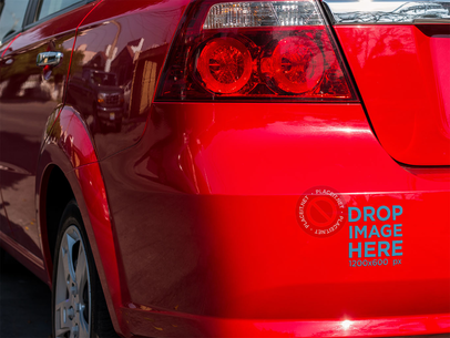 Mockup of a Sticker on the Back Bumper of a Red Car a15347