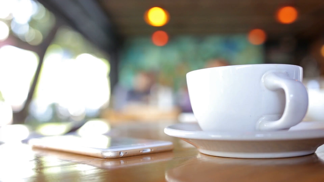 Landscape White iPhone 6 Plus App Demo Video Lying Next to a Coffee a15856