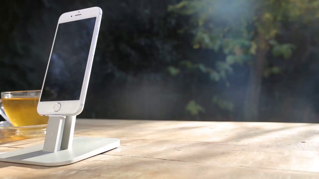 Front Shot of a White iPhone 6 App Demo Video Near a Tea and a Book a15781