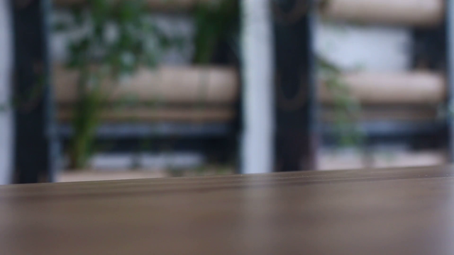 Front Shot of an iPhone 6 App Demo Video Standing Near a Man Drinking Coffee a15850