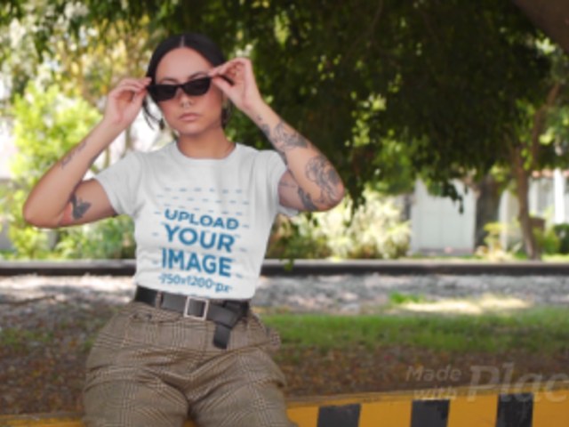 T-Shirt Video Maker Featuring a Tattooed Woman With Sunglasses Winking 3122v