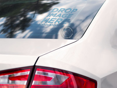 Square Decal Mockup on the Back Window of a White Car while Reflecting the Sky a15349