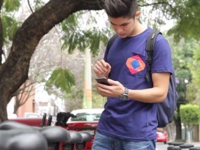 Teen Using iPhone 6 at Bicycle Station (With Gestures)