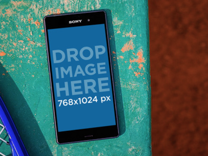 Android Mockup Featuring a Black Sony Xperia at a Tennis Court