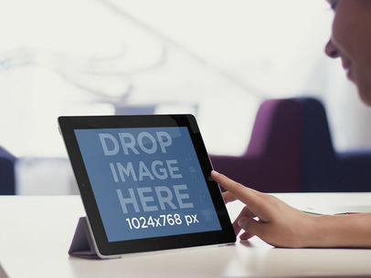 Black iPad Mockup Featuring a Girl at an Office Lounge