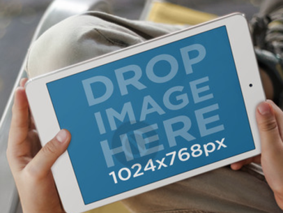 Tablet Mockup Featuring a Kid Using a White iPad a3557