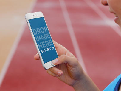 iPhone 6 Mockup of a Woman at a Running Track a4248