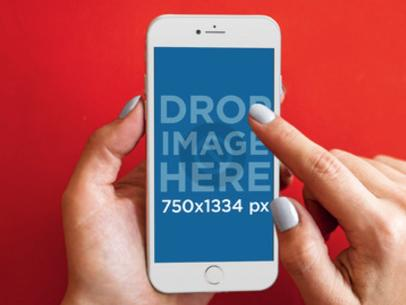 Mockup of a Woman Using an iPhone 6 Over a Red Background a4288