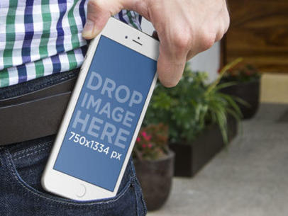 Man Putting His iPhone in His Pocket Mockup Template a4423