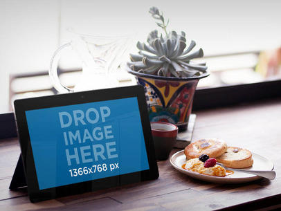 Mockup of a Windows Tablet on a Restaurant Table  a4336