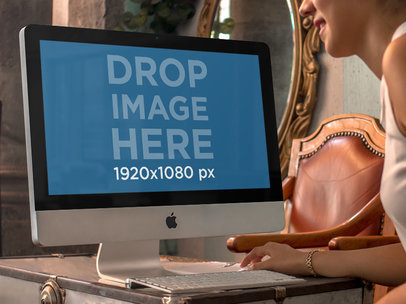 Saleswoman at a Vintage Store Using an iMac Mockup a4852-std