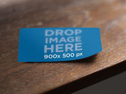 Business Card Mockup Lying on Top of a Wooden Table a6155