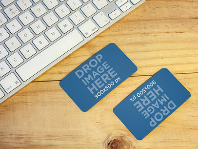 Mockup of Two Business Cards Lying On Top of a Desk at an Office a6292