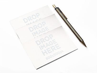 Mockup of 3 Business Cards Lying Next to a Metallic Pen a6304