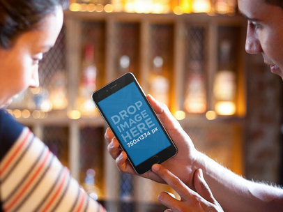 iPhone Mockup Featuring a Couple Using an iPhone 6 at a Restaurant a5589