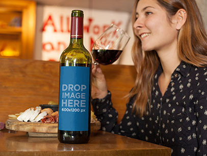 Label Mockup of a Wine Bottle Sitting on Top of a Restaurant Table a6989