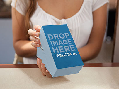 Packaging Mockup Featuring a Girl Opening a Present a6964