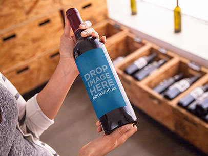 Label Mockup Featuring a Woman Holding a Wine Bottle a6701