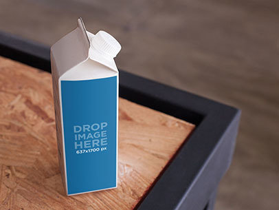 Packaging Mockup of a Milk Carton Over a Wooden Table a6694