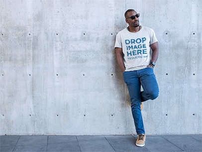 Black Man Leaning on a Concrete Wall T-Shirt Mockup a8972