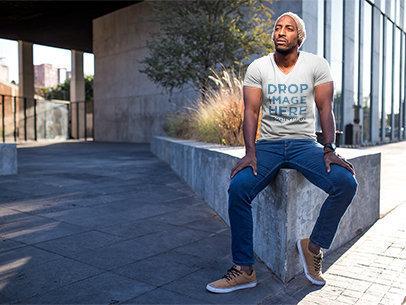 Black Man Sitting on a Concrete Planter T-Shirt Mockup a8978