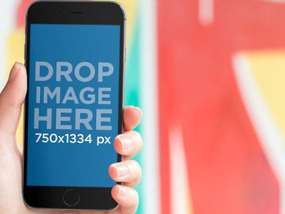 Mockup Template of an iPhone in Front of a Graffiti Wall 9301a