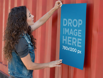 Poster Mockup of a Girl Taping a Poster to a Container a10409