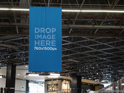 Vertical Banner Mockup Hanging From the Ceiling at an Airport a10694