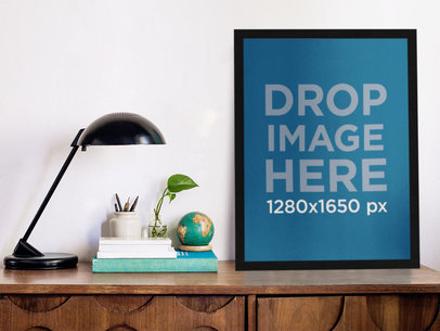 Mockup Template of a Poster Standing on a Wooden Desk a10399