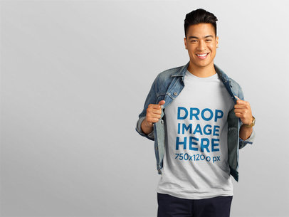 Smiling Asian Man Wearing a T-Shirt with Denim Jacket Mockup a11148