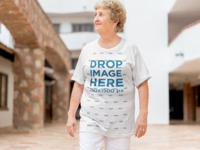 Smiling White Elderly Woman Wearing a T-Shirt Mockup a10938