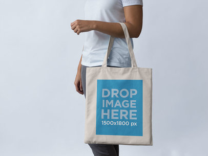 Mockup of a Tote Bag Being Carried on an Arm a11432