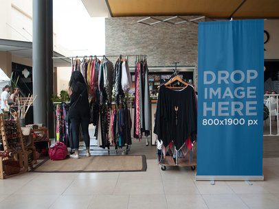 Roll-Up Banner Standing Next to a Boho Clothing Bazar a11271