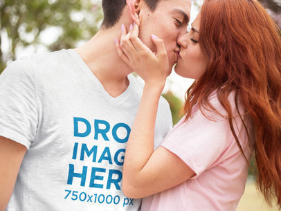 V-Neck T-Shirt Mockup Featuring a Young Couple Kissing a9387