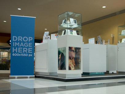 Mockup of a Roll-Up Banner at Cellphone Stand in a Mall a11297