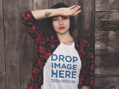 T-Shirt Mockup of a Grungy Woman Leaning on a Wooden Wall a11514