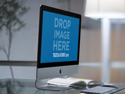iMac Mockup on a Glass Desk in a Modern Office a11759
