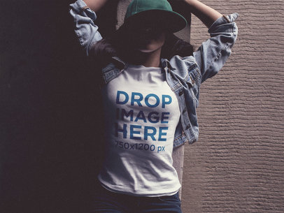 Tee Mockup of a Trendy Girl Wearing a Hat and Lying on Her Back  a11740
