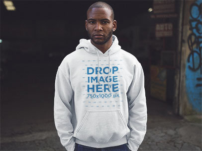 Pullover Hoodie Mockup of a Young Black Man at a Garage a12554