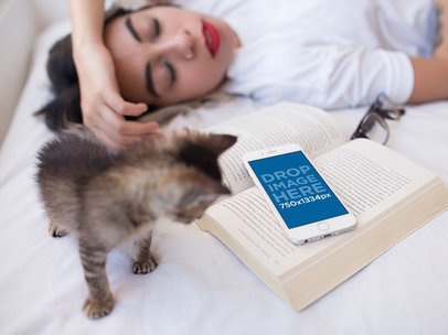 White iPhone 6s Mockup of a Woman Sleeping on her Bed with a Kitten and a Book a12800