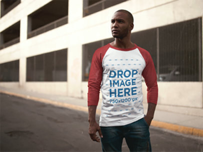 Handsome Black Man Wearing a Raglan Tee Outside a Parking Lot Mockup a12556