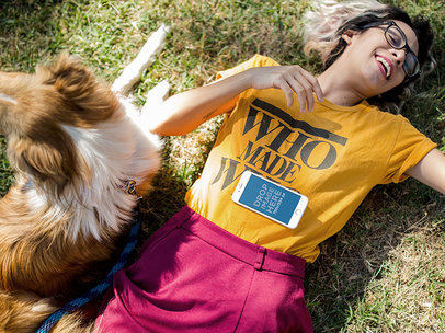 iPhone Mockup of a Young Woman Lying in the Grass with her Dog a12797