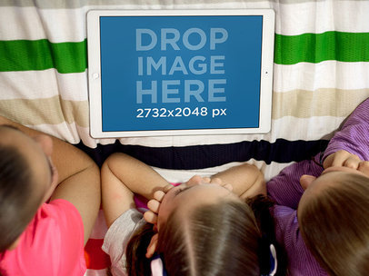 Three Little Girls Using an iPad Pro in their Room Mockup a12996