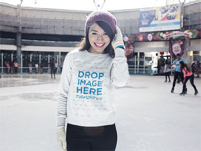 Heather Crewneck Sweatshirt Mockup of a Young Woman Ice Skating in Winter a13252