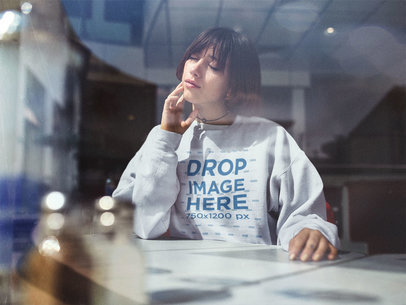 Trendy Young Woman Wearing a Crewneck Mockup and Choker at a Café a12668